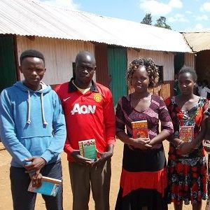 teachers with reading books at Compassion