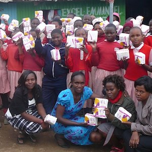Handing out sanitary towels at Excel Emmanuel